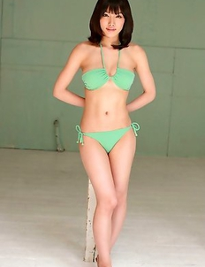 Anna Konno in green bath suit and heels is sexy and playful