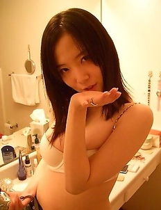 Smoking hot college teen getting naked in her bathroom